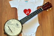 Little Jinky /  We Create Handmade, Hand printed, infant apparel, buy one and we will give one to a child in need. We are a husband and wife couple who started this venture in our home. We love art, found items, vintage, and music!