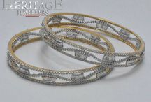 Bangles / Online diamond jewelry shopping for diamond bangle in India is now available at heritage jeweler's website.  / by Ramneet Kaur