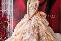 What's more beautiful than a light orange and pink wedding dress with pink flowers?