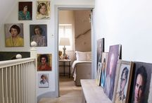 The neutral, biscuit carpet and light walls become the canvas for this home owners art work.
