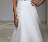 Belted Beauties - Wedding Dresses with Belts / Whether it's beaded, buckled or adorned with flowers, wedding dresses with belts add a touch of flair and often accent the smallest part of your waist. http://www.smartbrideboutique.com/blog/belted-beauties-wedding-dress-with-belts/20120730/934/