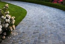 Distinctive Driveways / Paved driveways may be common place, but driveways crafted with pavers, bricks, and stone are opportunities for creativity and enhanced curb appeal for your home.