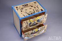 """Spinach Bedside Cabinet / A new career for Popeye! This cabinet upcycles a playfield from the classic pinball """"Popeye saves the earth"""". The cabinet has white ash veneer on the body, and inside the drawers. Adam Hall leather handles, and powder coated Adam Hall metal parts. It rolls on wheels, and is a lot of fun."""