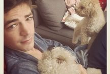 Grant Gustin / It's the guy from Glee, but he is holding puppies, which makes him that much prettier!