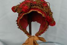 Bonnets, hats, antique dolls