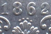 1862 4 DOTS BELOW DT ABOVE FLOWER