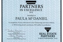 The Paula McDaniel Group's Awards / The Paula McDaniel Group is honored to be a winner of the following pinned awards.  The Paula McDaniel Group 423-355-0311 Real Estate Partners Chattanooga LLC. 423-362-8333. Equal Housing Opportunity. Licensed in TN and GA.