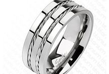Titanium Rings / An exceptional selection of mens titanium rings, plain, patterned, engraved, two tone etc. Available from www.badboyjewellery.com