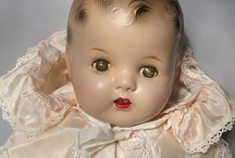 Vintage baby doll with tin eyes