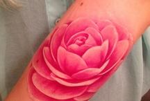 Tattoos / by Elizabeth Glaze