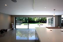 Project: Barrington Park Garden / Located in Chalfont St Giles is Barrington Park Garden. In this project, IQ Glass used bi-fold doors to allow the home gym to open up, connecting it to the patio/pool area. A glass roof light was also placed downstairs in the dining area along with sliding glass doors to create an open spaced feel.
