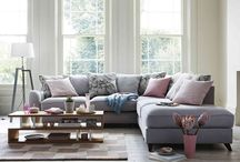 Pastel Pop / This season's greys become softer and pastel pinks more prominent. The soft colours and shapes of the furniture juxtaposed with sleek geometric pieces such as a statement floor lamp or coffee table give this relaxed look a design-led edge. Marble print cushions add a playful finishing touch