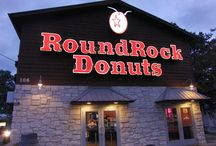 Roundrock Donut / About Round Rock Donuts Since 1926, people from all over the world have been stopping by to give our famous yellow (or are they orange?) donuts a try.  Round Rock Donuts, made from the original owner's recipe, are created with as much care and finesse as they were years ago. The yeast-risen donut originates from a bread-like dough; its distinct yellow color (from fresh eggs) immediately sets it off from any other donut.   Unlike baking powder donuts, this yeast donut cannot be machine-made.