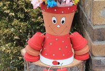 bonhomme en pot de fleurs