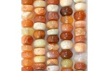 Mexican Fire Opal Beads and Chips / High quality Mexican Fire Opal gemstone beads, pendant focal beads and Mexican Fire Opal chip beads and Mexican Fire Opal cabochons at www.StonesNSilver.com.   Let our Gemstones, turquoise and Coral beads set your Jewelry Designs Apart from all the rest!