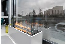 Floating Houses Bydgoszcz, Poland / Try to stop staring at this beautiful project. This combination of fire and water makes the interior perfectly balanced.