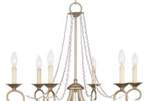 French Country Lighting / Inspired by antiques, French Country also features aged and softly painted finishes but are less historically accurate with muted colors of gold, sage and pale blue with iron or aged bronze metal details.