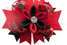 Feather Bows / A fun and adorable boutique feather hair bow with sweet curvy bow and feathers.
