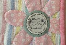 Quilt labels and backs / Interesting approaches to labeling and backing quilts.