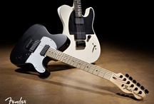 Guitars / Some really cool guitars and basses / by Michelle Sandlin