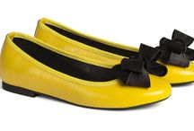 Y E L L O W // glistens / If you want to brighten up your outfit, yellow it's the perfect go-to color. Try yellow accessories and why not a pair of yellow shoes. Whatever material you will choose, the energetic and positive charge of yellow will be spread anyways. Yellow ballet flats are perfect for a sunny day. From classic shoes with little bow to ballerinas with a higher heel the watchword is to shine taking up big smiles and the yellow flats that fits you! #yellowcolour #yellowballetflats #yellowshoes