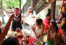 Cheers / Guests and tourists enjoying Bulgarian drinks and dishes at Baba Radka's house.
