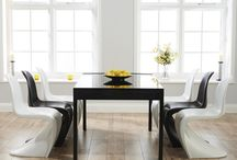 Monchrome homes / Black and white home interiors - sometimes paired with pops of bright colours too