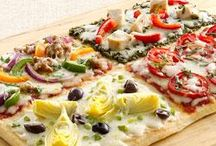 Pizzas and different toppings.