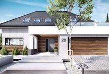 HomeKONCEPT 28 | Projekt domu / HomeKONCEPT-28 jest to wariant projektu domu HomeKONCEPT-26 z poddaszem użytkowym. W projekcie zwraca uwagę nowoczesna elewacja domu – zestawienie płyt betonowych z szlachetnym drewnem wraz z dopełniającym całości białym belkowaniem wokół domu. Zachwyca również przestronny taras z wyjątkowym wykończeniem. Wejście od frontu przyciąga wzrok swą niebanalnością – zostało delikatne przysłonięte przez drewniane belkowanie.