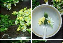 Flower arrangement in a floating tea cup