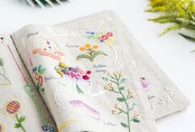 Embroidered book stitches and little bags