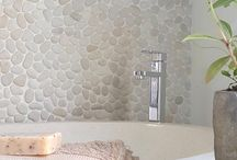 River Pebbles / This line of natural stone is light, bright, and neutral. River Pebbles come in both flat cut and round finishes. An accent wall, shower floor, or outdoor walkway are all made more beautiful with River Pebbles. http://surfaceartinc.com/stone/itemlist/category/480-river-pebbles.html