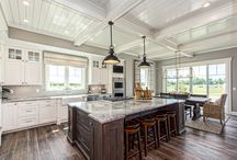 Powell Kitchen and Bar Remodel / This kitchen and bar design in Columbus Ohio is perfect for entertaining guests and family. Gorgeous lighting, Grabill cabinets, granite countertops, and stainless steel appliances line the kitchen island, dining room, living room and bar.