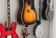 Guitar storage ideas. / Cool ways to display hang or store guitars ukulele basses banjos violins mandolins and other string instruments.