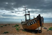 Old Boats / Washed up and weather-beaten fishing boats, small yachts and rowing boats.