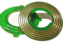 Pancake Slip Ring / Pancake slip ring as a new application category slip ring, which can be divided into simulation turntable slip ring and test turntable slip ring according to its using place. Generally speaking, turntable slip ring is specially designed for using on turntable equipment, and this kind of slip ring normally apply for high-end fields.