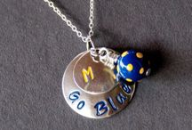 Michigan Wolverines / Find some of the cutest Michigan gameday dresses, gameday jewelry, and gameday accessories to look gorgeous on gameday! Cheer on your Michigan Wolversines in style.