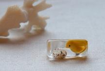 Objetos feitos com resina e/ou vidro