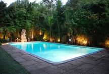 Garden with Swimming Pool / Find a perfect  garden with a swimming pool. A lovely example of a simple freeboard pool with a safety cover in the back garden of a London.