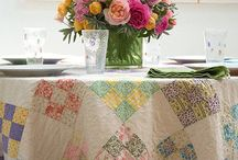 Quilts as Tablecloths / If you're a true quiltaholic, you have no more room on your walls to display your creations. No worries. You can use quilts for tablecloths too. So keep on quilting. To inspire you, here's a board full of nothing but quilt tablecloths. #quilts #tablecloths