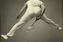 Badminton / Badminton is a racquet sport played by either two opposing players or two opposing pairs, who take positions on opposite halves of a rectangular court that is divided by a net.