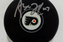 Hockey Pucks / NHL sports memorabilia
