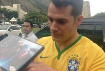Henry Cavill wears Brazilian football uniform as he signs autographs for fans / To please his fans in Rio de Janeiro, Henry Cavill put on the football uniform of the Brazilian national team and went out to sign autographs and take pictures right before The Man from U.N.C.L.E. Red Carpet event. 2015