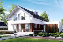 HomeKONCEPT 3 | Projekt domu / HomeKONCEPT-03 to projekt niedużego, eleganckiego domu dla jednej rodziny, stworzony z myślą o zapewnieniu maksymalnej wygody użytkowania. Strefa dzienna zaprojektowana została w kształcie litery L. Taki układ umożliwił umiejscowienie części wypoczynkowej z dala od hałasów kuchennych, lecz z zachowaniem przestronnego  charakteru całości.