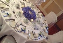All that glitters / A beautiful crystals table centre with a pale blue hydrangea pad finished off with a few chrome tea lights. Crystals centre piece can be used in many ways and is for hire.
