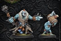 Trollbloods / Caught amid the destructive wars of man, the many tribes of the trollkin have united to save their kind and drive out those who despoil their lands. Led by mighty warlocks who can summon ferocious full-blood trolls to their side and backed by hearty trollkin warriors, pygmy sharpshooters, and powerful champions who have banded together to forge their own legends, the trollkin are prepared to stand their ground against any army that dares threaten them.