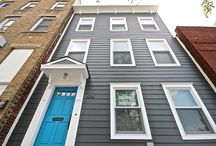 James Hardie Siding Project in Brooklyn, NY /  This James Hardie Siding project took place in Brooklyn, NY. The color choice of this project was James Hardie's Iron Gray. Every window was replaced and a beautiful blue door was added to make this Brooklyn home really stand out. The owners were very happy with there newly renovated Brooklyn home.