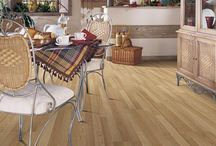 Laminate flooring / Beautiful laminate flooring that has traditional, hand-scraped, distressed, or stone and tile looks.