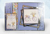 A Touch of Shimmer / The Touch of Shimmer range features a glistening range of images, including birds, flowers, bikes, and Champagne scenes, all with a beautiful shimmering pearlescent finish.