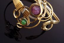 Wirework jewellery /  Each piece is a unique, handcrafted design. I work with alpacca, brass, copper ( silver on request) along with a variety of gemstones. I can realize your own ideas, using the stones of your choice. I apply a wide range of ancient and modern wirework techniques and styles from all over the world, such as chain maille, wire wrapping, wire weaving, forging or latin style. I hope you will enjoy the effects of my work as much as I enjoy the process of creating!